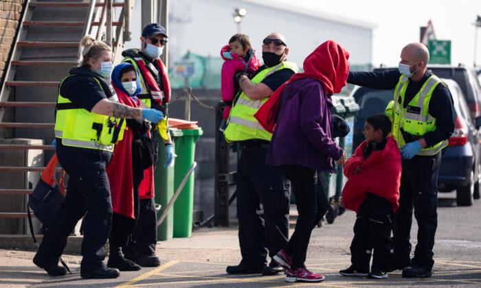 A migrant family is taken into port after being intercepted by Border Force officials in the English Channel, in Dover, England, on Sept. 22, 2020. (Luke Dray/Getty Images)