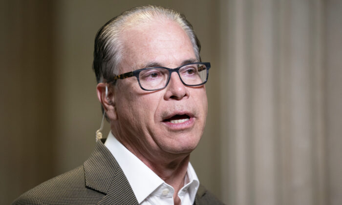 Senator Mike Braun (R-Ind.) speaks during a television interview in Senate Russell Office Building in Washington on Oct. 20, 2020. (Stefani Reynolds/Getty Images)