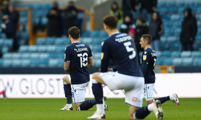Ryan Leonard of Millwall kneeling for Black Lives Matter during the Sky Bet Championship match between Millwall and Derby County at The Den in London, on Dec. 05, 2020. (Jacques Feeney/Getty Images)