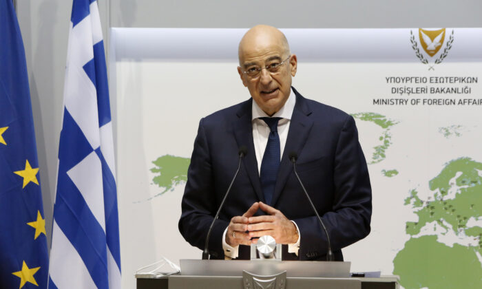 Greek Foreign Minister Nikos Dendias addresses a press conference with his Cypriot counterpart following their meeting in Nicosia, Greece, on Dec. 4, 2020. (Petros Karadjias/POOL/AFP via Getty Images)
