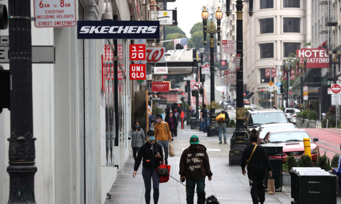 Fewer than normal shoppers walk through San Francisco's Union Square shopping district in San Francisco on Sept. 3, 2020. (Justin Sullivan/Getty Images)