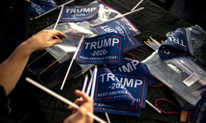 Supporters of President Trump put together miniature flags in Austin, Texas, on Nov. 3, 2020. (Sergio Flores/AFP via Getty Images)