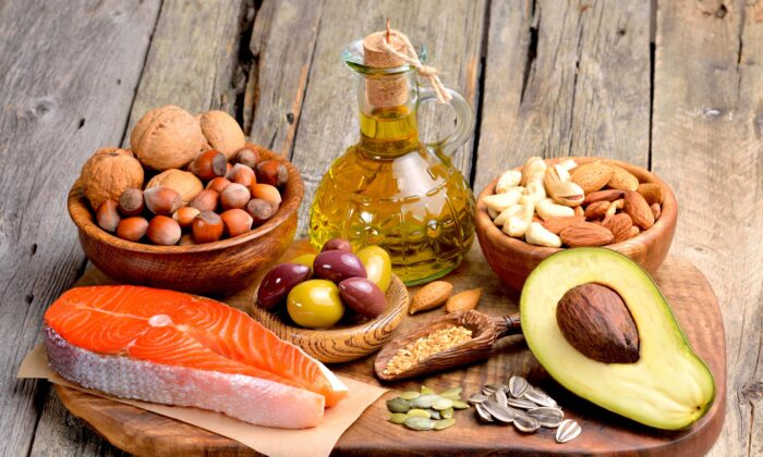 Healthy fats like those found in olive oil, salmon, avocado, and a selection of nuts and seeds can have immune-strengthening effects.(Craevschii Family/Shutterstock)