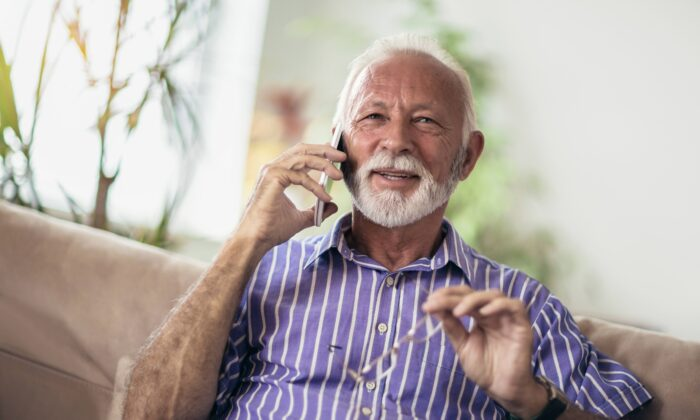Pick up the phone or start a video chat with a friend or family member in need. Connecting with them will help both of you feel better.(adriaticfoto/Shutterstock)