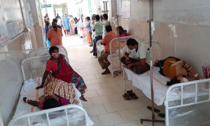 Patients and bystanders at the district government hospital in Eluru, Andhra Pradesh state, India, on Dec. 6, 2020. (AP Photo)
