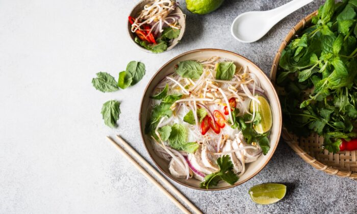 An assortment of fresh herbs, among other crunchy, raw veggie fixings, is essential to the pho experience. (Sentelia/Shutterstock)
