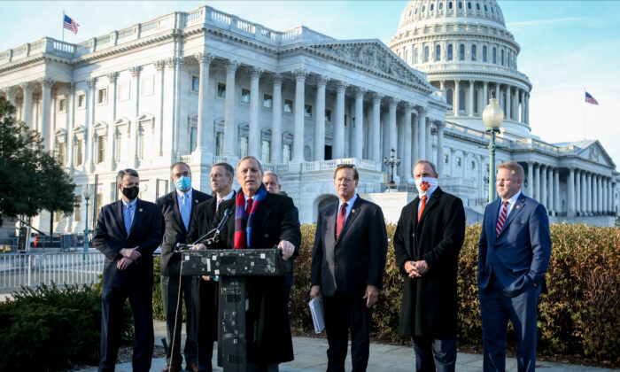 Rep. Andy Biggs (R–Ariz.) speaks alongside members of the House Freedom Caucus during a press conference outside the Capitol building in Washington on Dec. 3, 2020. (Charlotte Cuthbertson/The Epoch Times)