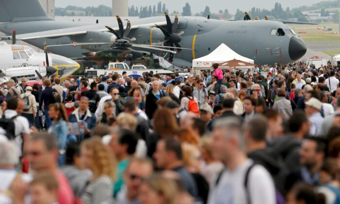 Visitors walk at the static display area during the last day of the 51st Paris Air Show at Le Bourget airport near Paris on June 21, 2015. (Pascal Rossignol/Reuters)