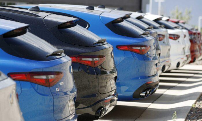A long row of unsold 2020 Stelvio sports-utility vehicles sits at an Alfa Romeo dealership in Highlands Ranch, Colo., on July 19, 2020. (David Zalubowski/AP Photo)