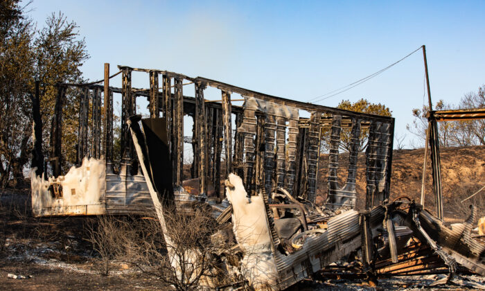 A structure lies in ruins following the Bond Fire in Silverado Canyon, Calif., on Dec. 3, 2020. (John Fredricks/The Epoch Times)