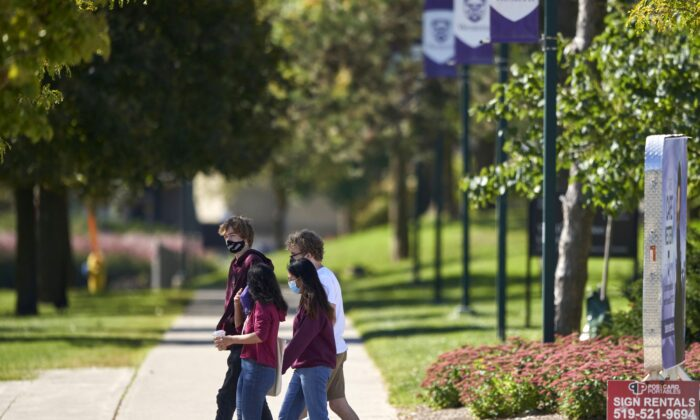 Students walk across campus at Western University in London, Ont., on Sept. 19, 2020. (The Canadian Press/Geoff Robins)