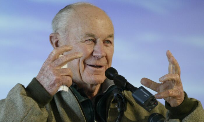 General Chuck Yeager, the first person to break the sound barrier, speaks to a crowd Dec. 16, 2003 during the weeklong First Flight Centennial Celebration that is taking place at the Wright Brothers National Memorial in Kill Devil Hills, North Carolina. (Ellen Ozier  ELO/GAC/Files/Reuters)