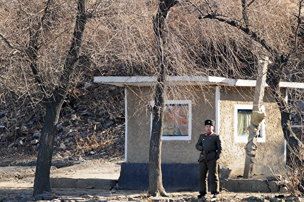A North Korean soldier in Siniuju patrols the shoreline of the Yalu River border across from Dandong in northeast China's Liaoning Province on Nov. 25, 2010. (Frederic Brown/AFP/Getty Images)