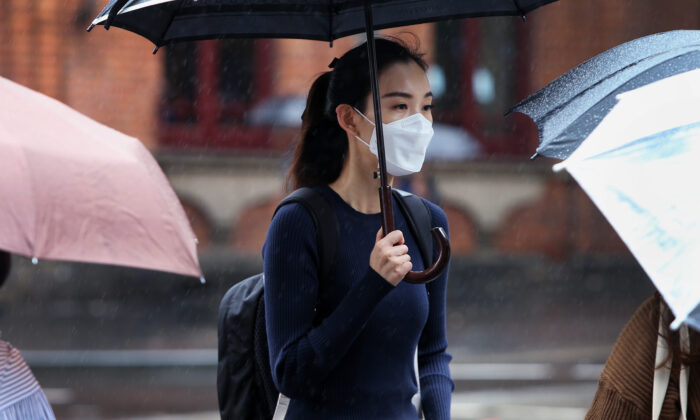 A woman wears a face mask as she walks through the Chinatown district on March 04, 2020 in Sydney, Australia. (Lisa Maree Williams/Getty Images)