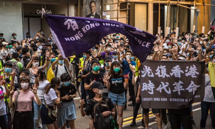 Protesters chant slogans during a rally against a new national security law in Hong Kong, on July 1, 2020. (Dale De La Rey/AFP via Getty Images)