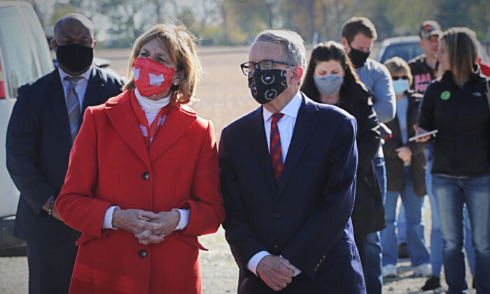 Republican Ohio Gov. Mike DeWine along with his wife Fran, waits in line to vote at the Cedarland Event Center in Cedarville, Ohio, on Nov. 3, 2020. (Marshall Gorby/Dayton Daily News via AP)