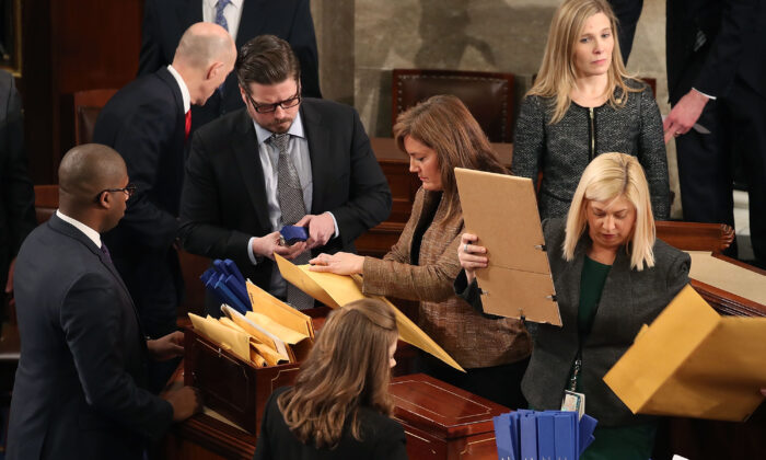 Staffers organize state's ballots during the counting of the electoral votes from the 2016 presidential election during a joint session of Congress in Washington on Jan. 6, 2017. (Mark Wilson/Getty Images)