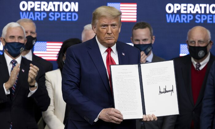President Donald Trump signed an executive order at the Operation Warp Speed Vaccine Summit in Washington on Dec. 8, 2020. (Tasos Katopodis/Getty Images)