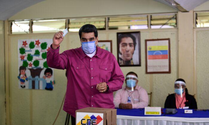 Venezuelan President Nicolas Maduro casts his vote at a polling station in the Simon Rodriguez school in Fuerte Tiuna, Caracas, on Dec. 6, 2020 during Venezuela's legislative elections. (Yuri Cortez/AFP via Getty Images)