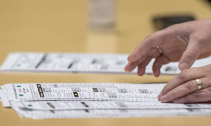 A election worker shows ballots to representatives for President Donald Trump during the presidential recount for Dane County, in Madison, Wis., on Nov. 20, 2020. (Andy Manis/Getty Images)