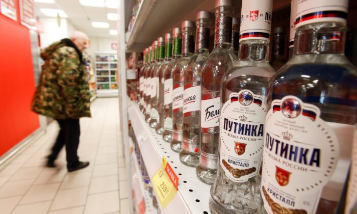 A customer walks past shelves with bottles of vodka in a supermarket amid the coronavirus disease (COVID-19) pandemic in Moscow, Russia, on Apr. 8, 2020. (Maxim Shemetov/Reurers)