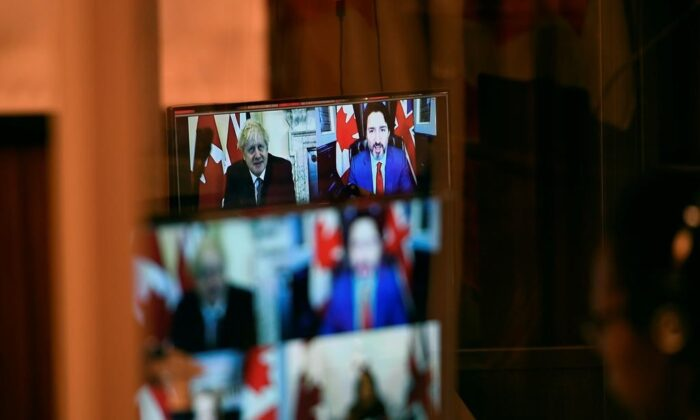 Canadian Prime Minister Justin Trudeau and U.K. Prime Minister Boris Johnson are seen in a pre-recorded video from an earlier videoconference during a news conference on the Canada-United Kingdom Trade Continuity Agreement in Ottawa, on Nov. 21, 2020. (The Canadian Press/Justin Tang)