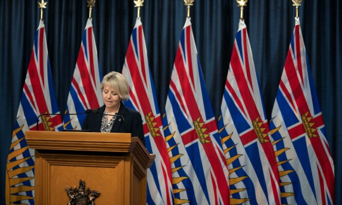 Dr. Bonnie Henry pauses for a moment as she gives her daily media briefing regarding COVID-19 for the province of British Columbia in Victoria, B.C, on Dec. 7, 2020. (The Canadian Press/Jonathan Hayward)