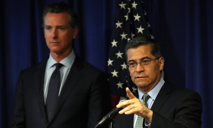 California Attorney General Xavier Becerra (R) speaks as California Gov. Gavin Newsom looks on during a news conference at the California justice department in Sacramento, Calif. on Sept. 18, 2019. (Justin Sullivan/Getty Images)
