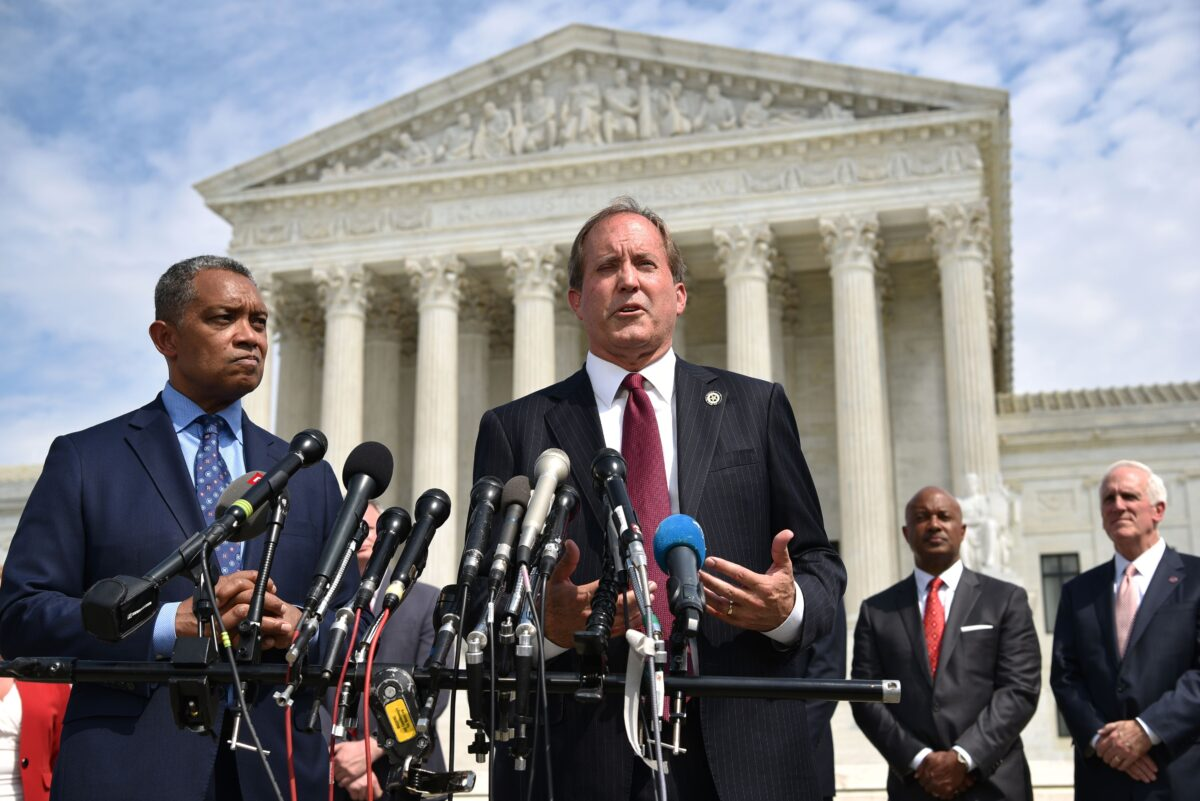 District of Columbia Attorney General Karl Racine (L) and Texas Attorney General Ken Paxton