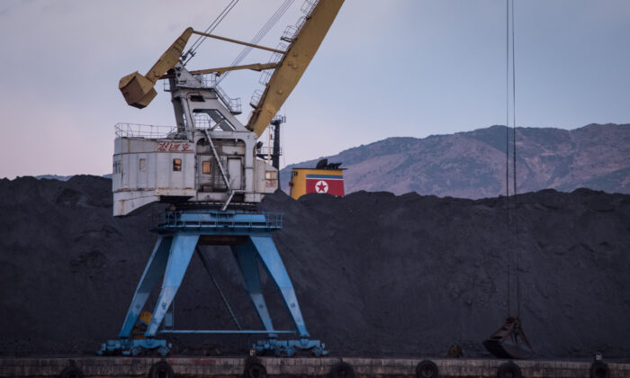 A mountain of coal is piled up on one side of the barrier in Rajin Harbour, North Korea, on Nov. 21, 2017. (Ed Jones/AFP via Getty Images)