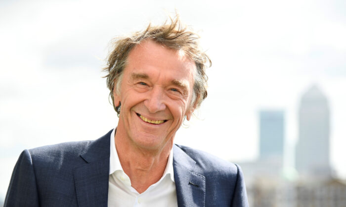 File photo shows Jim Ratcliffe, CEO of British petrochemicals company INEOS, posing for a portrait with the Canary Wharf financial district seen behind, in London, on April 26, 2018. (Toby Melville/Reuters)
