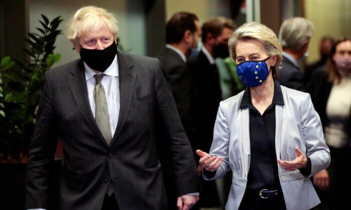 European Commission President Ursula von der Leyen welcomes British Prime Minister Boris Johnson in Brussels, Belgium, on Dec. 9, 2020. (Olivier Hoslet/Pool via Reuters)