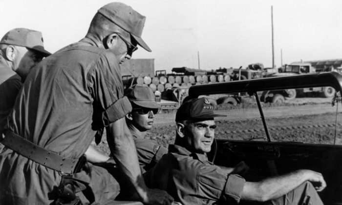 U.S. General William Childs Westmoreland (1914–2005) sitting in a jeep during an inspection of the Mekong Delta base camp of the 9th Infantry Division near Long Thanh, Vietnam War, circa 1966. Sitting atop the jeep behind the general is Colonel James W. Phillips, commander of the 9th Infantry Division Artillery.  (Hulton Archive/Getty Images)