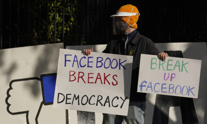 A demonstrator joins others outside of the home of Facebook CEO Mark Zuckerberg to protest what they say is Facebook spreading disinformation in San Francisco on Nov. 21, 2020. (Jeff Chiu, AP Photo, File)