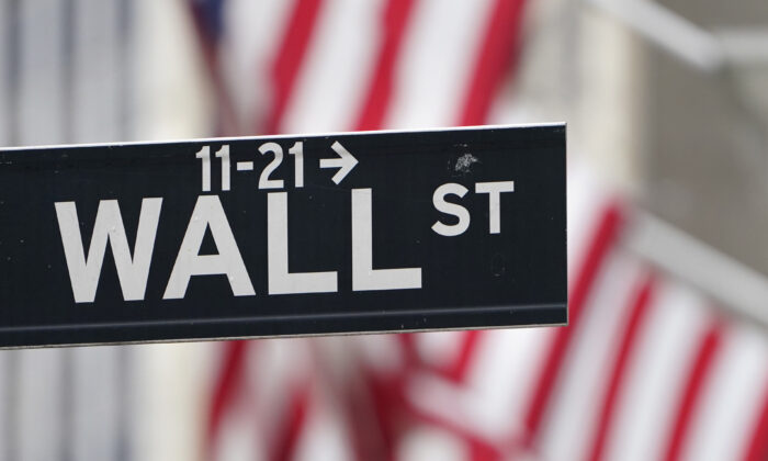 In this Nov. 23, 2020 file photo, a street sign is displayed at the New York Stock Exchange in New York. (Seth Wenig/ AP Photo, File)