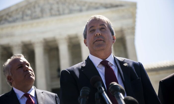 Texas Attorney General Ken Paxton speaks to reporters at a news conference outside the Supreme Court on Capitol Hill in Washington on June 9, 2016. (Gabriella Demczuk/Getty Images)