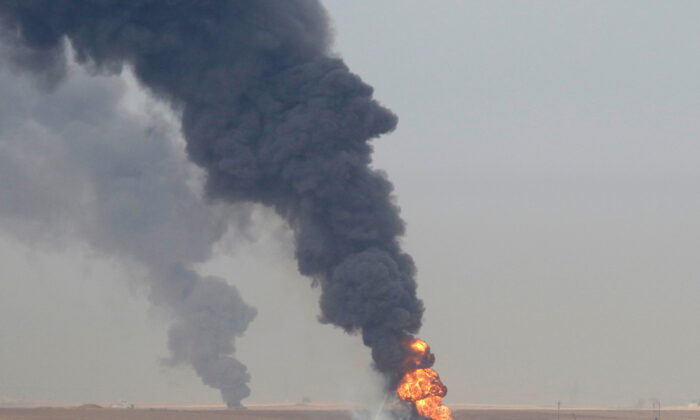 Smoke rises from oil wells inside the Khabbaz oilfield after they were bombed on the outskirts of Kirkuk, Iraq, on Dec. 9, 2020. (Ako Rasheed/Reuters)