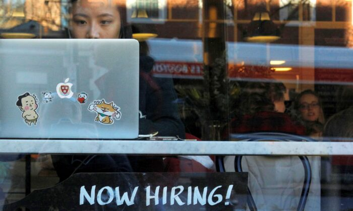 """A """"Now Hiring"""" sign sits in the window of Tatte Bakery and Cafe in Cambridge, Mass., on Feb. 11, 2019. (Brian Snyder/Reuters)"""