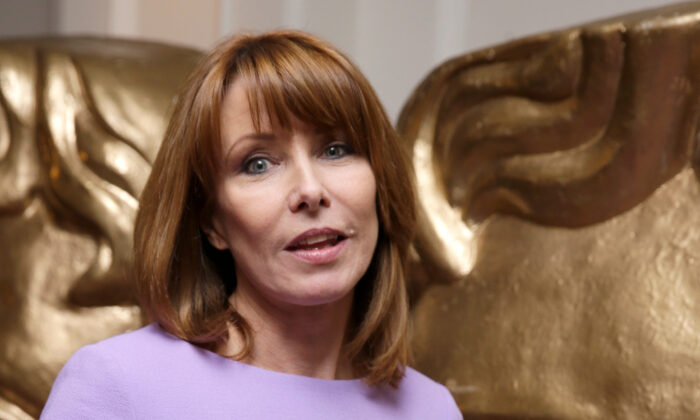 Kay Burley poses for photographers upon her arrival at the British Academy Television Nominees Party in London, on Apr. 22, 2015. (Joel Ryan/Invision/AP)