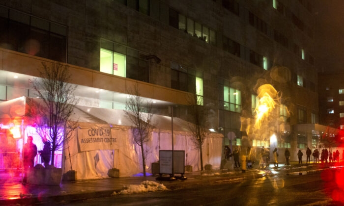 A queue forms outside a COVID-19 testing centre in Toronto, on Dec. 9, 2020. (The Canadian Press/Chris Young)