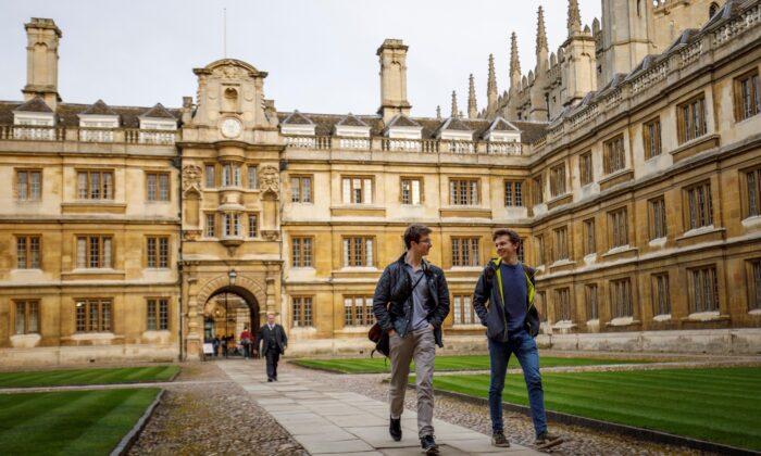 Students walk through Cambridge University in Cambridge, England, on March 14, 2018. (Tolga Akmen/AFP via Getty Images)