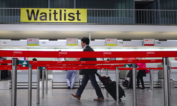 A passenger enters Zurich airport in Switzerland on April 20, 2010. (Fabrice Coffrini/AFP via Getty Images)
