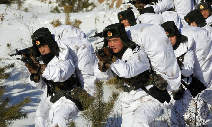 Chinese soldiers take part in a winter training session in Heihe, northeast China's Heilongjiang province, on Jan. 28, 2015. (STR/AFP via Getty Images)