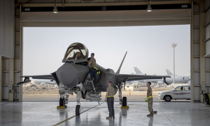 An F-35 fighter jet pilot and crew prepare for a mission at Al-Dhafra Air Base in the United Arab Emirates on Aug. 5, 2019. (Staff Sgt. Chris Thornbury/U.S. Air Force via AP)