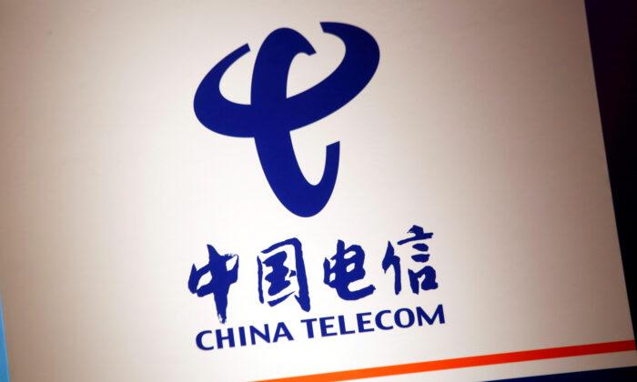 The company logo of China Telecom is displayed at a news conference in Hong Kong, China, on Aug. 20, 2018. (Bobby Yip/Reuters)