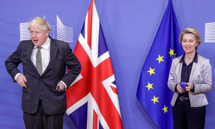 UK Prime Minister Boris Johnson is welcomed by European Commission President Ursula von der Leyen prior to a working dinner at the EU headquarters in Brussels, Belgium, on Dec. 9, 2020. (Olivier Hoslet/Pool/AFP via Getty Images)