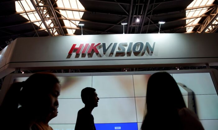 People visit a HIKVision booth at the security exhibition in Shanghai, China, on May 24, 2019. (Aly Song/File Photo/Reuters)