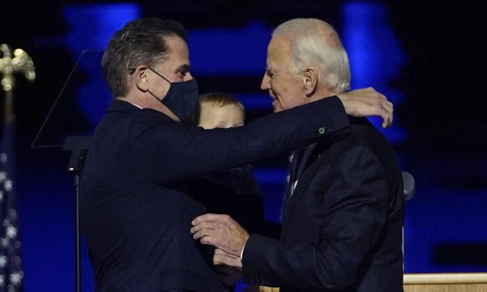 Hunter Biden (L) embraces his father, Democratic presidential nominee Joe Biden, in Wilmington, Del., on Nov. 7, 2020. (Andrew Harnik/Pool/AP Photo