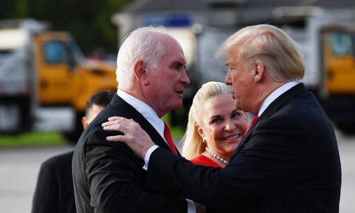 President Donald Trump greets Rep. Mike Kelly and his wife Victoria upon arrival at Erie International Airport in Erie, Pennsylvania on October 10, 2018. (Photo by MANDEL NGAN / AFP)
