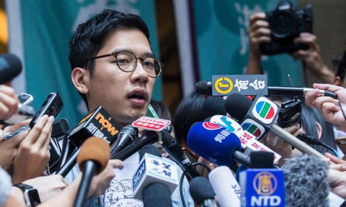 Pro-democracy activist Nathan Law speaks to the media outside the Court of Final Appeal after he and Joshua Wong's (not pictured) bail applications were successful at Hong Kong's highest court on Oct. 24, 2017. Jailed democracy activists Joshua Wong and Nathan Law were released on bail pending an appeal against convictions for their role in the 2014 Umbrella Movement protests. (Isaac Lawrence/AFP via Getty Images)